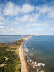 Aerial view of a beautiful sandy beach on the Atlantic Ocean. Taken in Cavendish, Prince Edward Island, Canada.