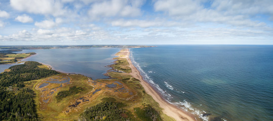 Wall Mural - Aerial panoramic view of a beautiful sandy beach on the Atlantic Ocean. Taken in Cavendish, Prince Edward Island, Canada.