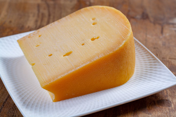 Beemster cheese, hard Dutch cheese made from cow milk from grass grown on sea-clay in a polder 4 meters below sea-level