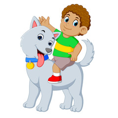 a litte boy is on the big grey dog for playing