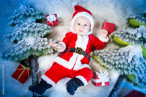 de25e28ce7f78 Christmas. New Year. Santa Claus with gifts. A child dressed as ...