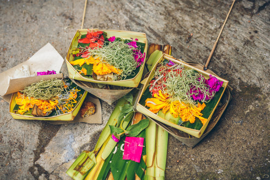 Floral offerings in straw baskets for Hindu spirits and gods for religious reasons in Ubud, Bali, Indonesia.