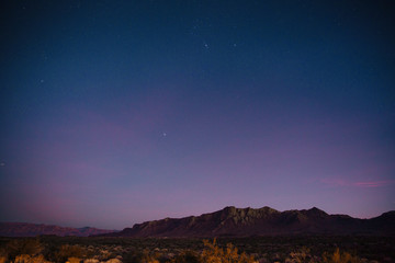 The sun sets and the stars start to shine on a road trip through the desert in Nevada.