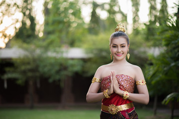Beautiful Woman wearing typical Thai dress