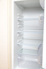 empty open refrigerator close-up