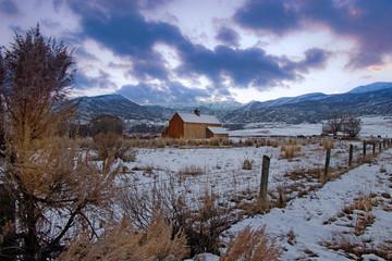 Old wooden barn in a winter landscape