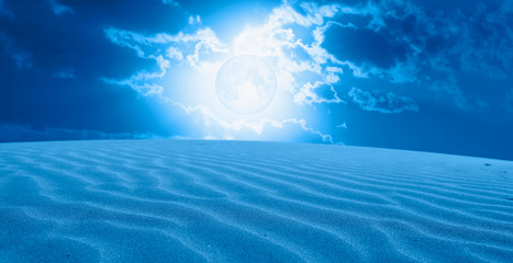 "Night sky with blue moon in the clouds with desert (sand dune)""Elements of this image furnished by NASA"