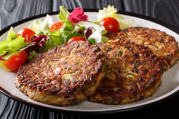 Vegetarian menu: mushroom vegetable patty with fresh salad on a plate close-up. horizontal