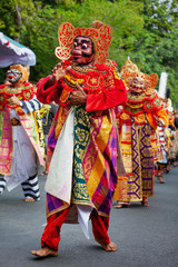 Dancer men in traditional Balinese costumes and masks Tari Wayang Topeng - characters of Bali culture. Temple ritual dance at ceremony on religious holiday. Ethnic festivals, arts of Indonesian people