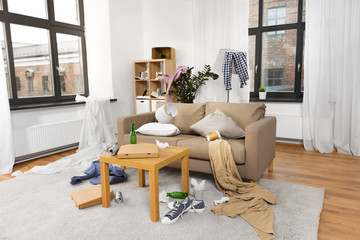 mess, disorder and interior concept - view of messy home living room with scattered stuff
