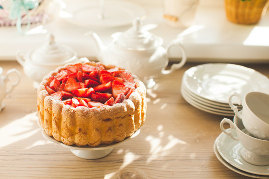 French Fresh Strawberry charlotte and kitchen dishes