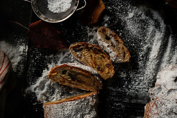 Pieces of Stollen near sieve and autumn leaves
