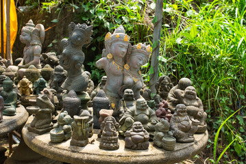 Stone table full of religious figurines. Bali, Indonesia