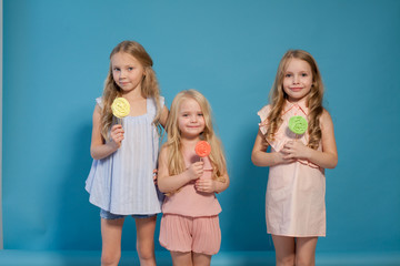 eat sweet candy lollipop three little girls blonde