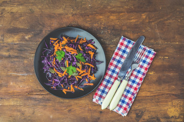 Salad of purple cabbage, carrots pumpkin seeds and parsley