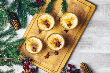 Homemade eggnog in glasses, top view, copy space