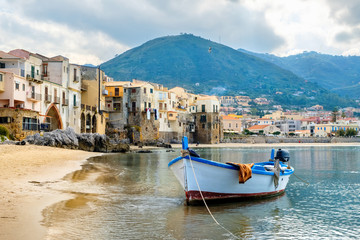Photo on textile frame City on the water Harbour of Cefalu. Sicily, Italy