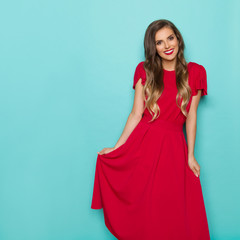 Beautiful Smiling Young Woman In Long Red Dress