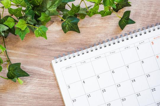 Calendar on the desk or table デスクまたはテーブルの上のカレンダー