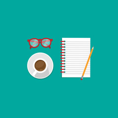 creative freelance workplace with red glasses, coffee and note book.