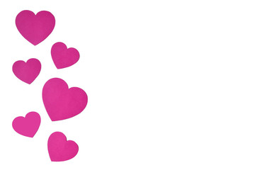 Isolated pink paper hearts in line sideways in form of a decorative frame on a white background.
