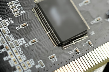 Close-up of electronic chip in desktop computer motherboard circuit.