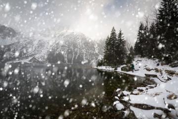Heavy snowfall at Eye of the Sea lake in Tatra mountains, Poland