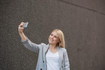Close up of beautiful Caucasian woman taking selfie.