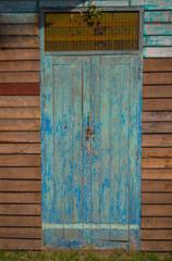 The door is made of old wood.