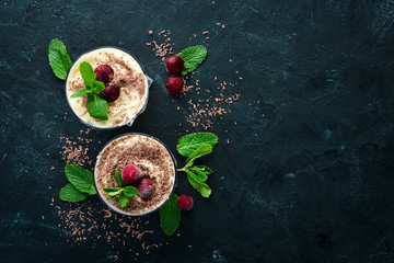 Dessert Tiramisu with cherries. Top view. Free space for your text.