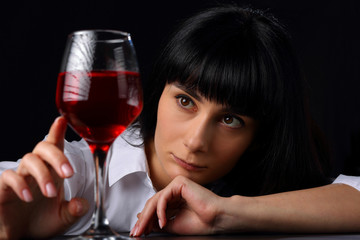 Bored girl with a glass of red wine
