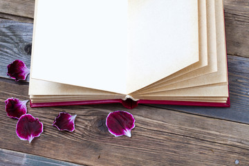 open book with geranium petals