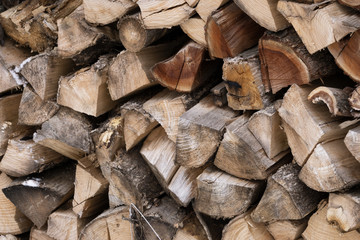chopped firewood folded. for background. wood texture. alternative type of fuel.