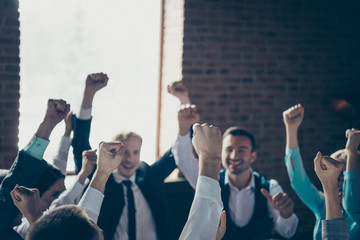 Organization power accomplishment support community concept. Close up view photo of excited satisfied glad partners raising fists up celebrating best luck Wall mural