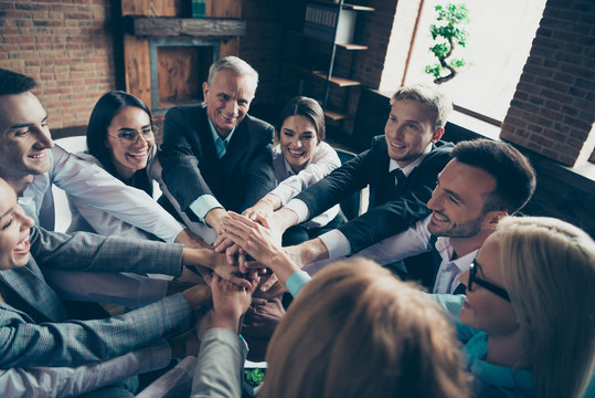 Close up photo of many people celebrating laugh laughter income earnings development investment startup showing gesture hands together all dressed in formal wear jackets shirts