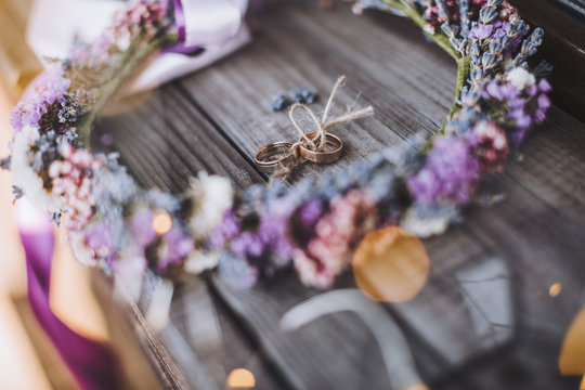 wedding rings in a wreath of lavender