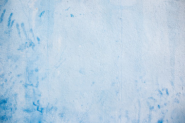Blue concrete wall background.