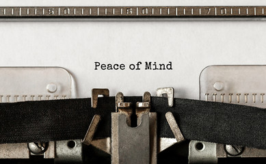 Text Peace of Mind typed on retro typewriter