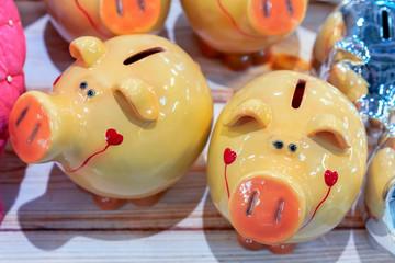 Yellow ceramic piggy bank on the counter of a souvenir shop. Symbol of 2019.