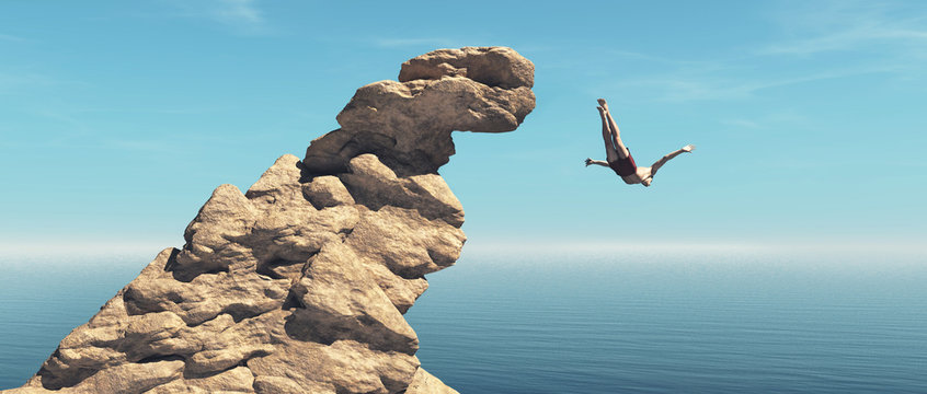 Man jumps into the ocean from a cliff.