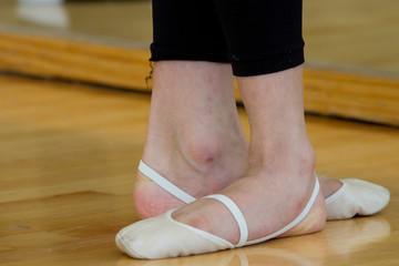 Gymnast feet with toe shoes