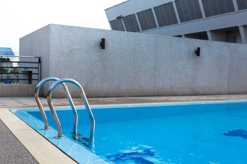 Stair at swimming pool side, water sport and recreation in the outdoor area