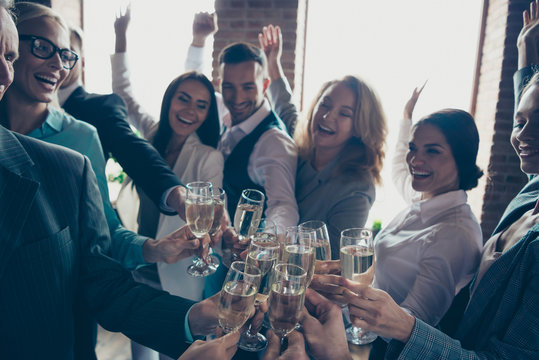 Close up photo of large big company of people having fun in office drinking golden beverage glad to have christmas holidays cheers all dressed in formal wear jackets shirts suits