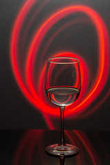 Drink at bar in a night time, wine glass with white wine and freeze light on a background. New year party drink.