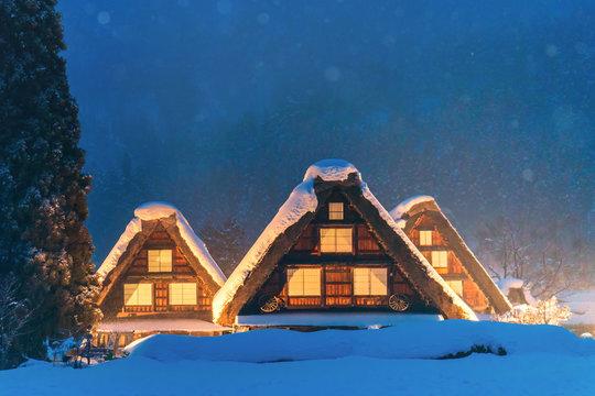 Snow falling on light Up Festival in winter at shirakawago Gifu Chubu Japan