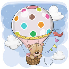 Cute Teddy Bear is flying on a hot air balloon