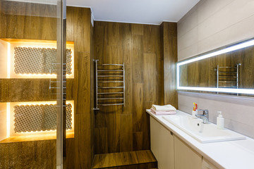 Brown bathroom including bath and sink, 3d render