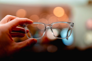 A pair of glasses with yellow bokeh in the background Wall mural