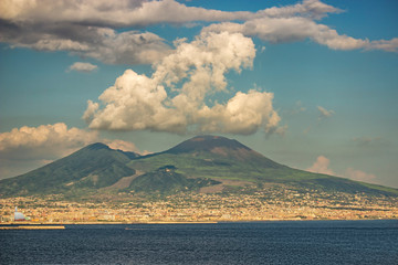 Naples, seen on posillipo and on the,  semi covered by white clouds, vulcano vesuvius
