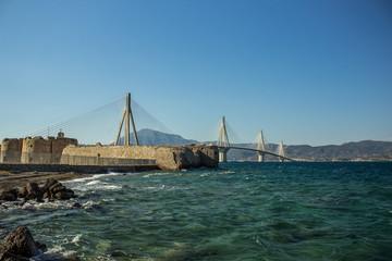 bridge urban city building landmark above sea vivid blue water surface